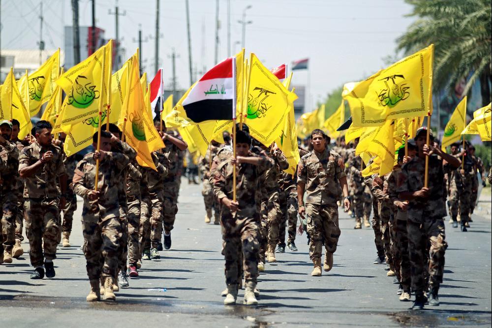 עיראקים שיעים, חברי הכוח הגיוס העממי, מציינים את יום אל-קודס בבגדאד, 23 ביוני 2017 (רויטרס)