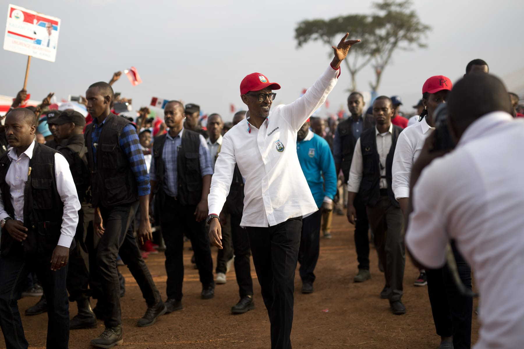 Rwanda's President Paul Kagame wave as he leaves an election campaign rally on the hills overlooking Kigali, Rwanda, Wednesday Aug. 2, 2017. Kagame has been in power since the end of the country's genocide in 1994 and is widely expected to win another term in the Aug. 4 elections after the government earlier this month disqualified all but three candidates. (AP Photo/Jerome Delay) (AP)