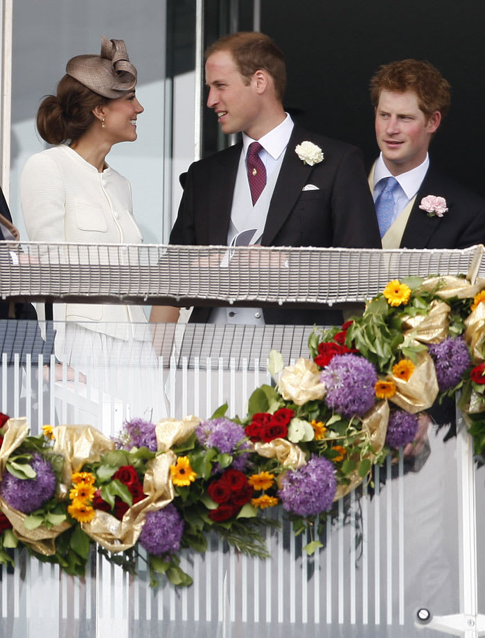 Britain's Duke and Duchess of Cambridge, left, and Prince Harry wait for the start of the Derby during the Derby Festival at Epsom Downs Racecourse in Epsom, England, Saturday, June 4, 2011 (AP , Akira Suemori)