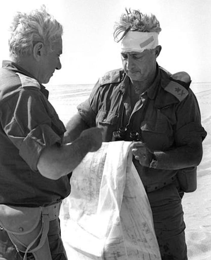 אריאל שרון וחיים בר לב בחזית הדרום במהלך מלחמת יום הכיפורים (AP , Israel Government Press Office/HO)